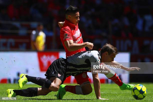 Efrain Velarde of Toluca struggles for the ball with Claudio Riano of Necaxa during the 12th round match between Toluca and Necaxa as part of the...