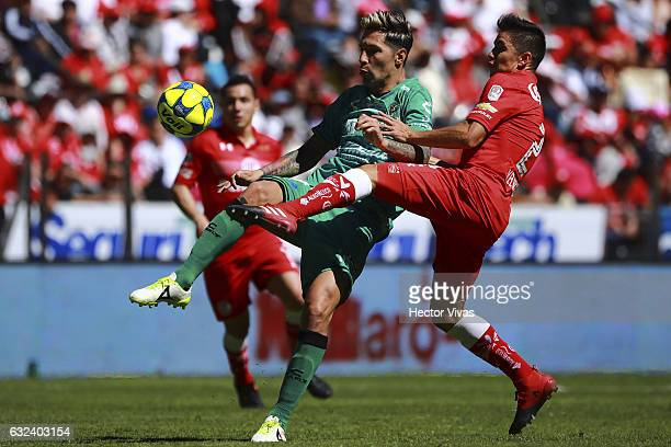 Efrain Velarde of Toluca struggles for the ball with Jonathan Fabbro of Chiapas during a match between Toluca and Chiapas as part of the Clausura...
