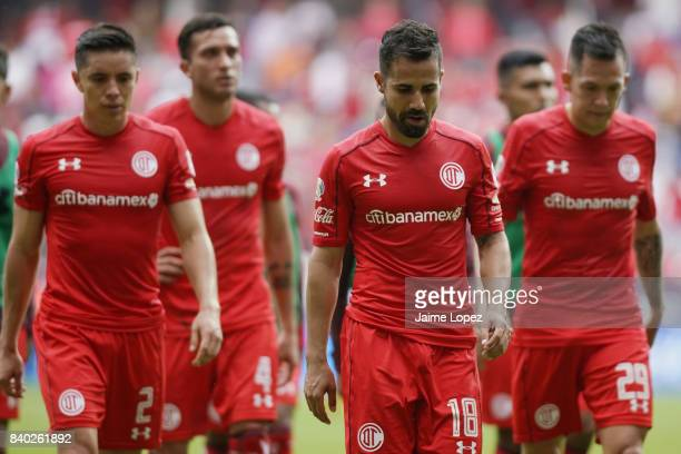 Efrain Velarde Rodrigo Lopez and Rodrigo Salinas of Toluca leave the field at the end of the first half during the seventh round match between Toluca...