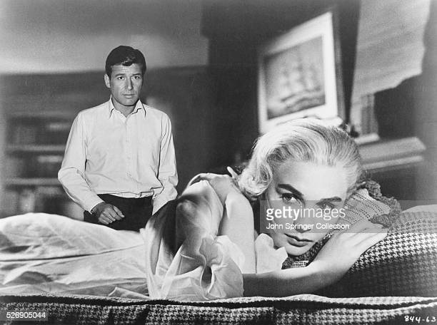 Efrem Zimbalist Jr as Jacob Diamond and Jean Simmons as Charlotte Brown in the 1958 film Home Before Dark