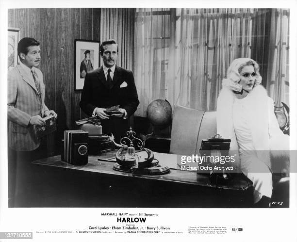 Efrem Zimbalist Jr Barry Sullivan and Carol Lynley standing in office a scene from the film 'Harlow' 1965