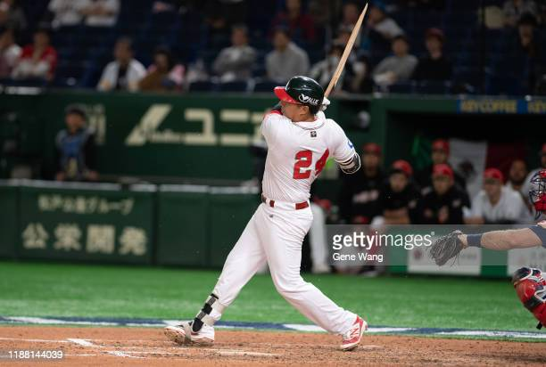 Efren Navarro of Team Mexico hits a gamewinning hit during the WBSC Premier 12 Bronze Medal final game between Mexico and USA at the Tokyo Dome on...