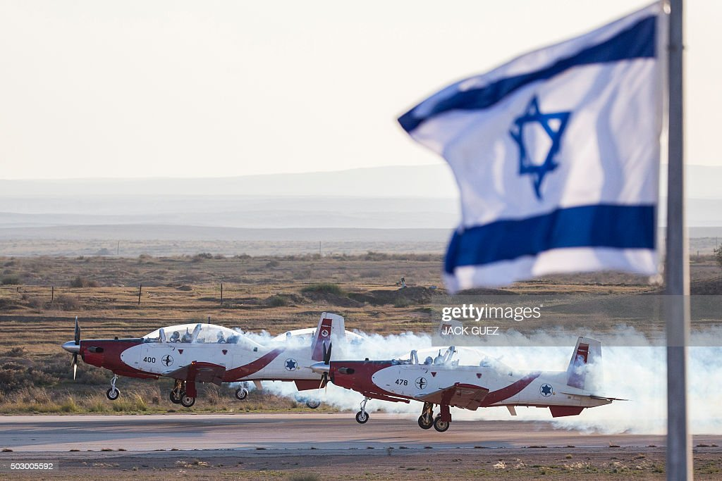 Efroni T-6 Texan II planes take off during an air show for a graduation ceremony at the Hatzerim base in the Negev desert, near the southern Israeli city of Beersheva, on December 31, 2015.