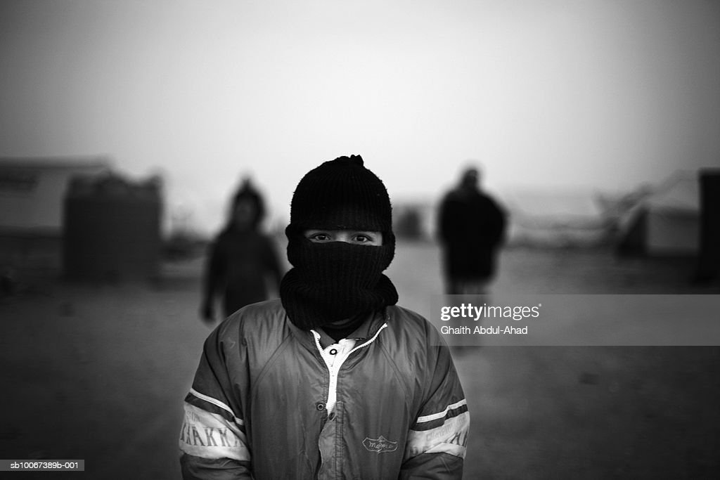 Iraq, No Mans Land, boy in ski cap in refugee camp