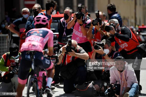 Egan Arley Bernal Gomez of Colombia and Team INEOS Grenadiers Pink Leader Jersey & Stuart Franklin of United Kingdom Photographer at Getty Images at...