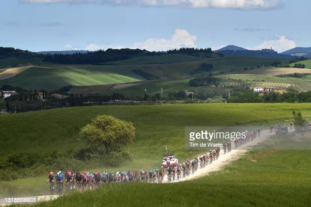 Egan Arley Bernal Gomez of Colombia Pink Leader Jersey & Filippo Ganna of Italy and Team INEOS Grenadiers lead The Peloton passing through a gravel...