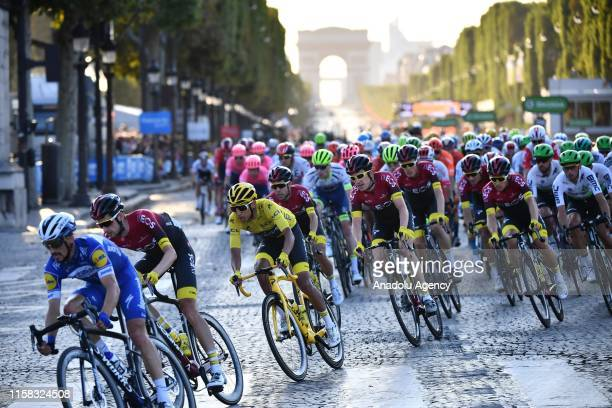 Egan Bernal, 3th left, of Colombia competes on the Champs-Elysees avenue during the Paris Champs-Elysees stage of the Tour de France 2019 in Paris,...