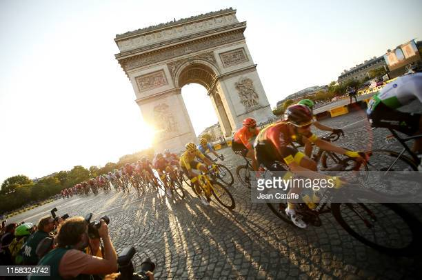 Egan Bernal Gomez of Colombia and Team Ineos passes with the pack in front of Arch of Triumph at the top of Avenue des Champs Elysees during stage 21...