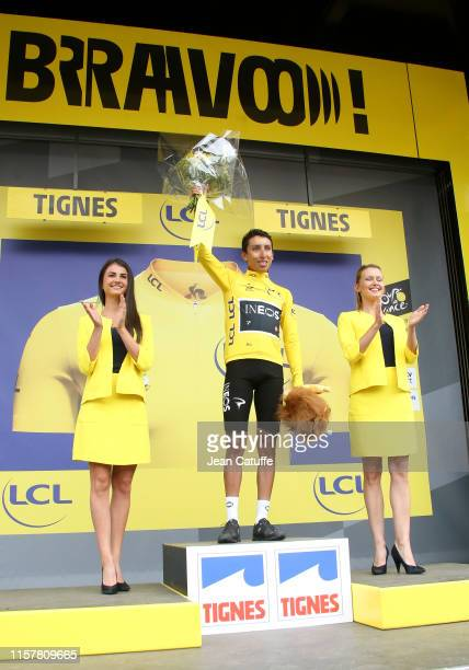 Egan Bernal Gomez of Colombia and Team Ineos receives the yellow jersey of leader of the race during the podium ceremony following stage 19 of the...