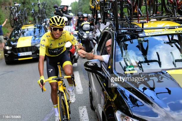 Egan Bernal of Colombia and Team INEOS Yellow Leader Jersey / Dave Brailsford of United Kingdom Team Manager of Team INEOS / Celebration / Champagne...
