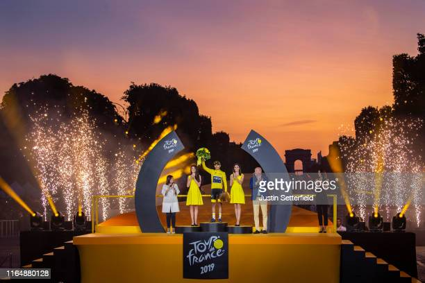 Egan Bernal of Colombia and Team INEOS Yellow Leader Jersey celebrates on the podium infront of the Arc De Triomphe during the podium ceremony of the...