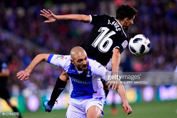 eganes' Moroccan forward Nordin Amrabat and Sevilla's Spanish midfielder Jesus Navas jump for the ball during the Spanish 'Copa del Rey' first leg...
