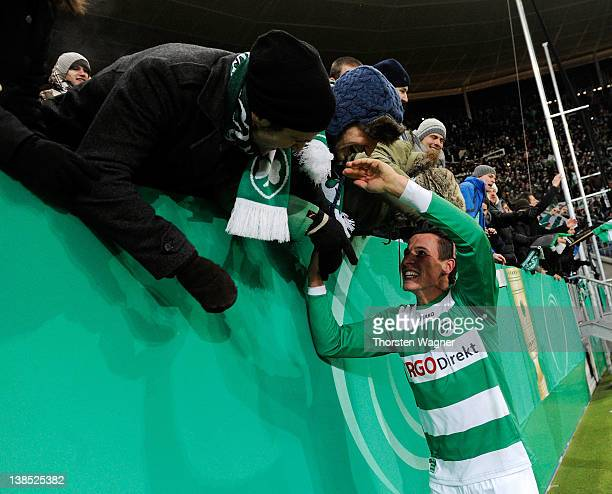Egar Prib of Fuerth celebrates with the fans after winning the DFB Cup Quarter Final match between TSG 1899 Hoffenheim and SpVgg Greuther Fuerth at...