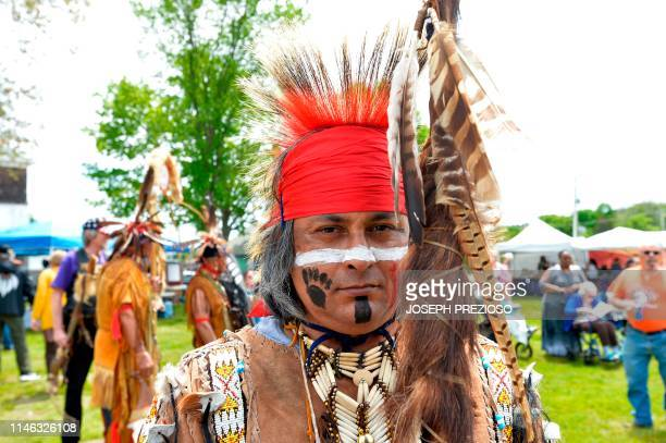 Egene, an Apache, in full dress awaits the start of the Grand Entry during the 29th Annual Spring Planting Moon Pow Wow run by the Massachusetts...
