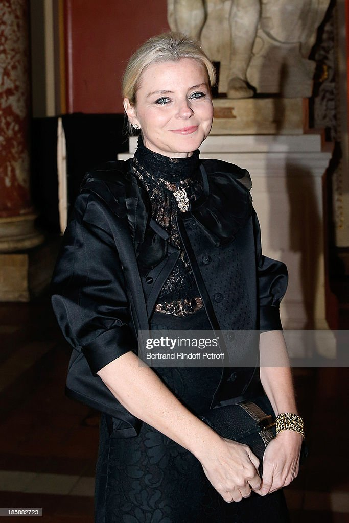 Egeria of artist Cesar, Stephanie Janssen, wearing a creation of Cesar - Designer Alber Elbaz pays tribute to Cesar Baldaccini by an Evening Pic-Nic at the Ecole Nationale Superieure des Beaux Arts de Paris on October 25, 2013 in Paris, France.