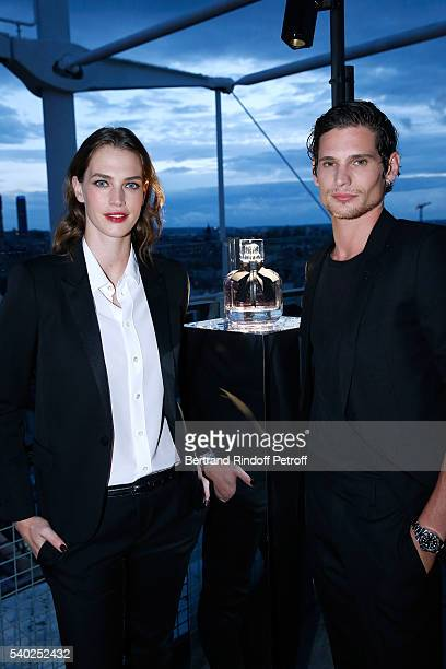 Egeria of YSL Beauty model Crista Cober and actor Jeremie Laheurte attend YSL Beauty launches the new Fragrance 'Mon Paris' at Cafe Le Georges on...