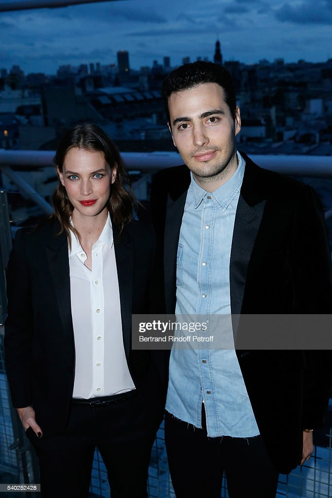 Egeria of YSL Beauty, model Crista Cober and Co-Founder of the 'Exemplaire Store', Jean-Victor Meyers attend YSL Beauty launches the new Fragrance 'Mon Paris' at Cafe Le Georges on June 14, 2016 in Paris, France.