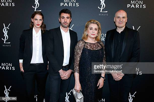 Egeria of YSL Beauty model Crista Cober guest actress Catherine Deneuve and General Director of of Yves Saint Laurent Stephan Bezy attend YSL Beauty...