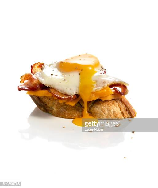 Egg and Bacon sandwhich on white background