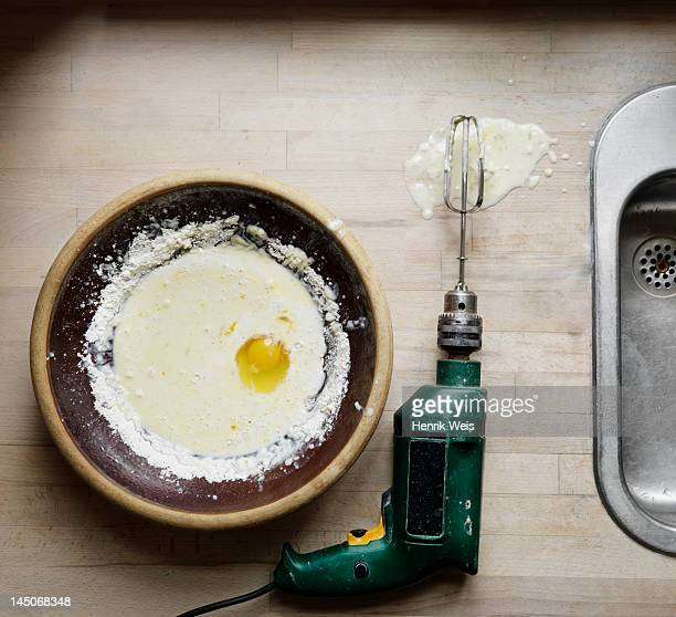 Egg and beater attached to power drill