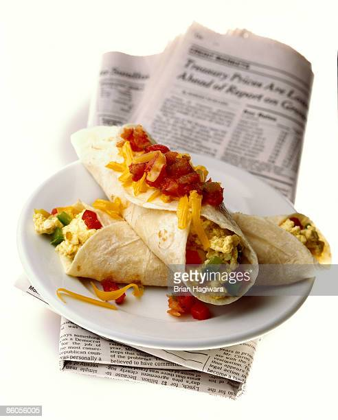 Egg burritos and newspaper