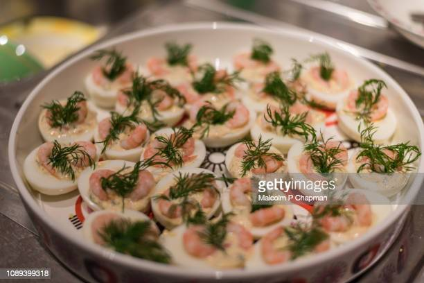 egg haves with prawn and dill on swedish christmas table - swedish culture stock pictures, royalty-free photos & images