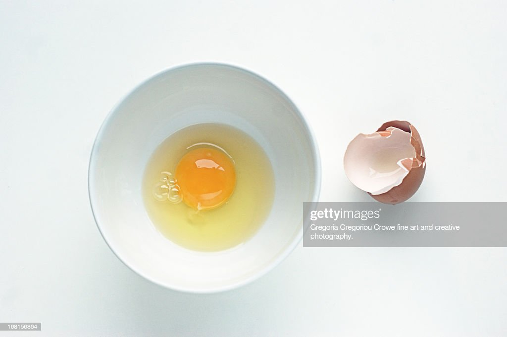 Egg in a white round bowl : Stock Photo