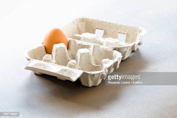 Egg In Carton On White Background