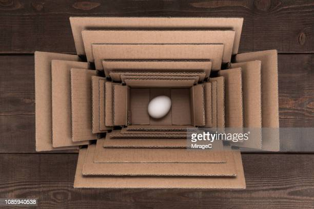 egg packed in multi layered boxes - protection stock pictures, royalty-free photos & images