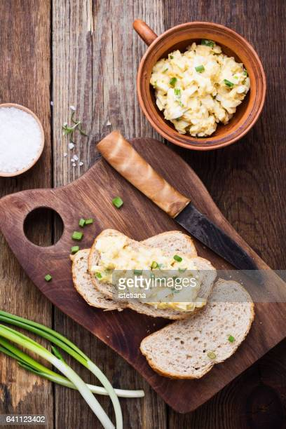 egg pasta sandwich with spring green onion - pate stock photos and pictures