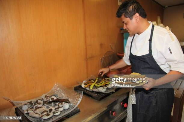 Egg plant or brinjal being roasted on hot stones on February 20 2020 in New Delhi India What did humans eat 5000 years ago in one of the earliest...