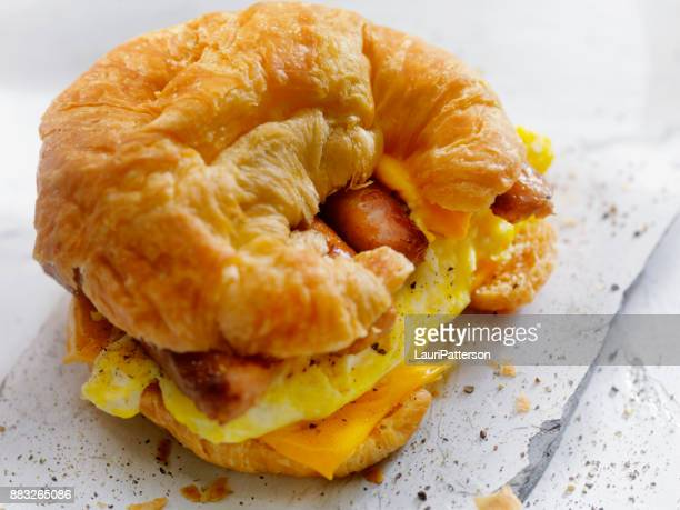 egg, sausage and cheese breakfast croissant - sandwich stock pictures, royalty-free photos & images