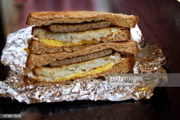 WASHINGTON DC DECEMBER Egg Sausage Hash Browns and Cheese Sandwich on Wheat Bread at Sunrise Cafe photographed in Washington DC on December 26 2018
