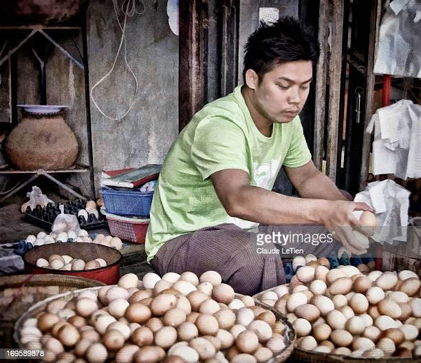 Egg vendor at the Nyaung Oo market