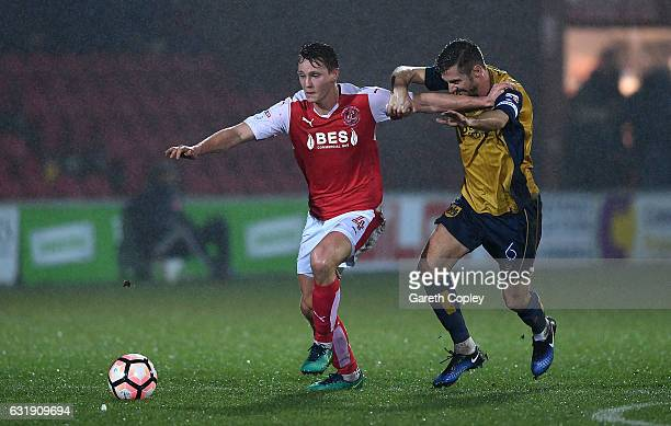 Eggert Jonsson of Fleetwood is tackled by Gary O'Neil of Bristol City during The Emirates FA Cup Third Round Replay between Fleetwood Town and...