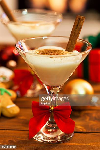 eggnog at christmas time - eggnog stock photos and pictures