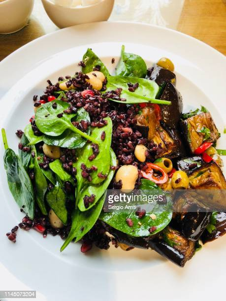 eggplant and black rice salad - black rice stock pictures, royalty-free photos & images