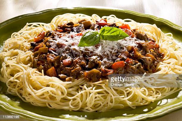 Eggplant combines with a veritable garden of flavors including garlic onion tomatoes bell pepper zucchini basil and parsley for a winning pasta sauce