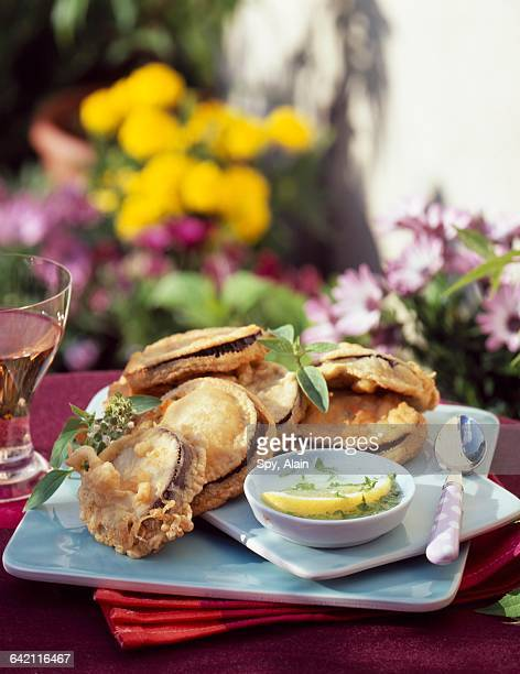 eggplant fritters with lemon and parsley sauce - breaded stock photos and pictures
