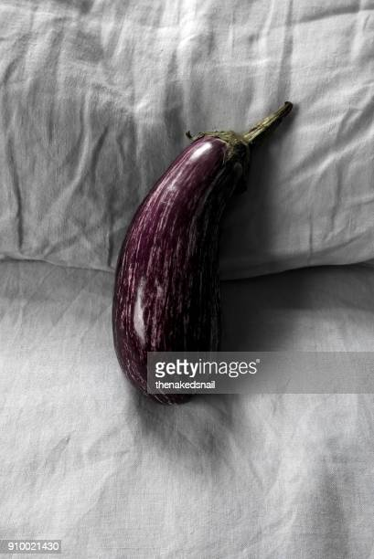 eggplant on bed - erectile dysfunction stock photos and pictures