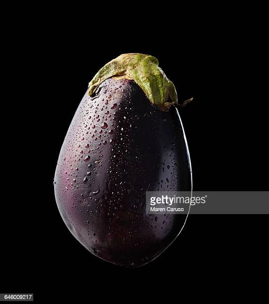 eggplant on black background - eggplant stock pictures, royalty-free photos & images