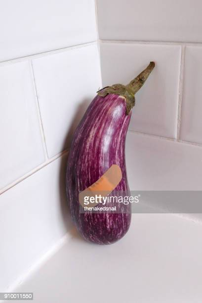 eggplant with band aid - erectile dysfunction stock pictures, royalty-free photos & images