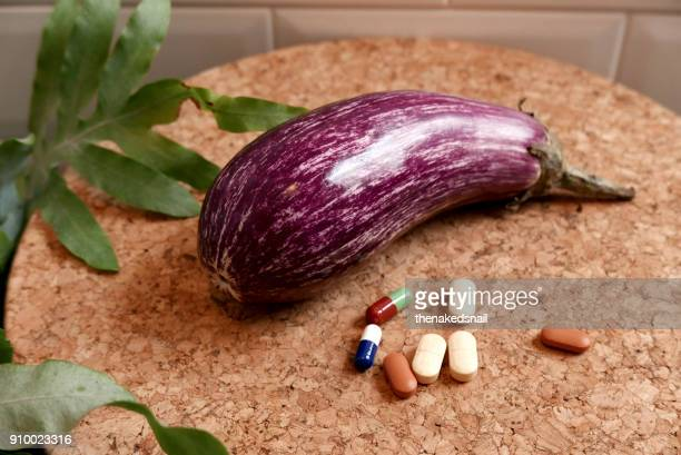eggplant with supplements - erectile dysfunction stock photos and pictures