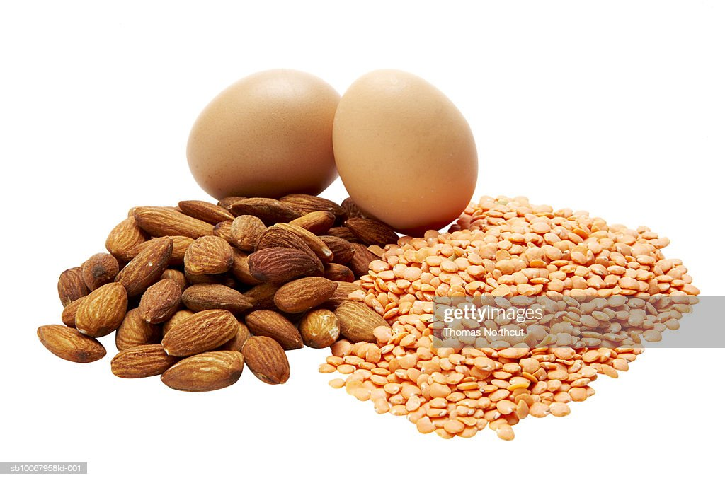 Eggs, almonds, and lentils on white background : Stock Photo