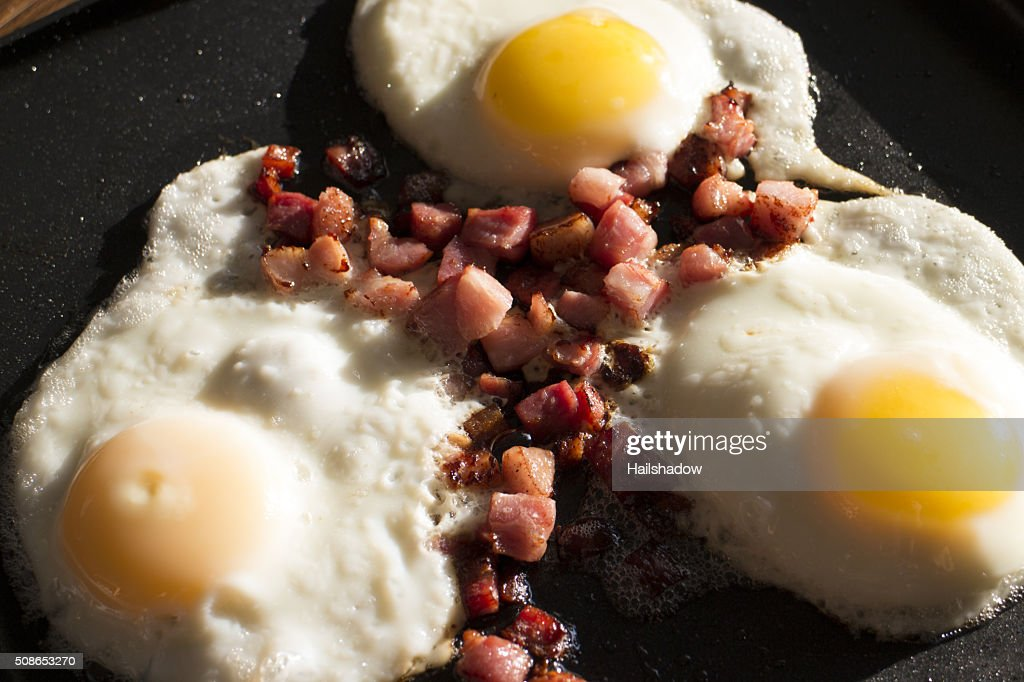 Eggs and bacon bits : Stock Photo