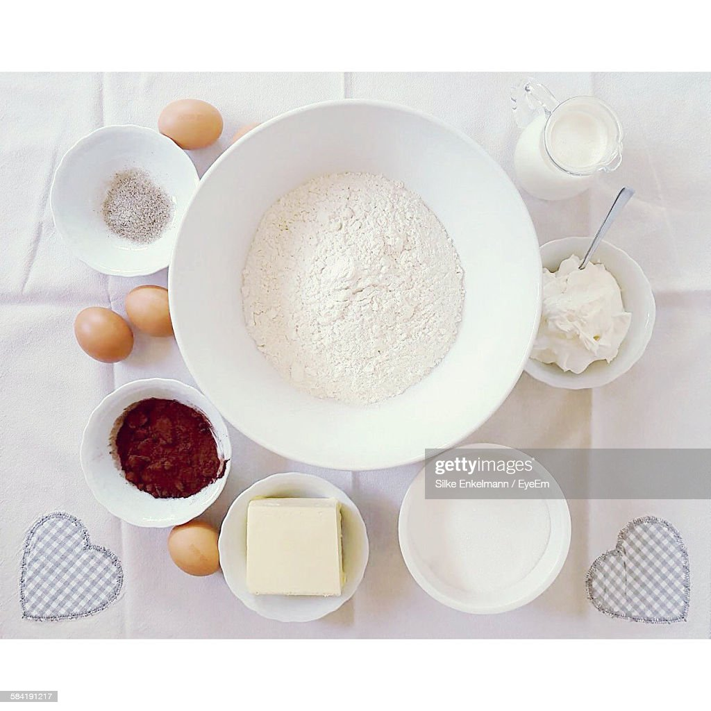 Eggs And Baking Supplies On Kitchen Table High-Res Stock ...
