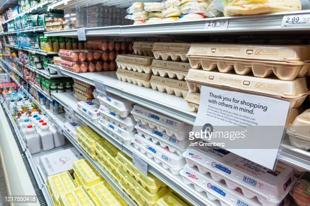 Eggs and Dairy aisle, Thank you for shopping with others in mind sign.