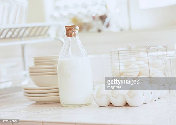 Eggs and milk  on kitchen counter