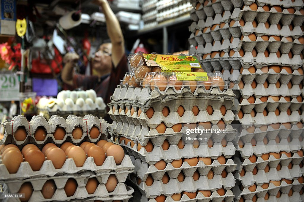 Eggs are displayed for sale at a market in Singapore, on Saturday, Dec. 29, 2012. Singapore may grapple with elevated inflationary pressures for a third year in 2013, reducing scope for the central bank to provide stimulus to an economy that probably entered a technical recession this quarter. Photographer: Munshi Ahmed/Bloomberg via Getty Images