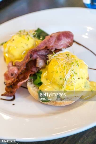 Eggs Benedict In White Plate On Table